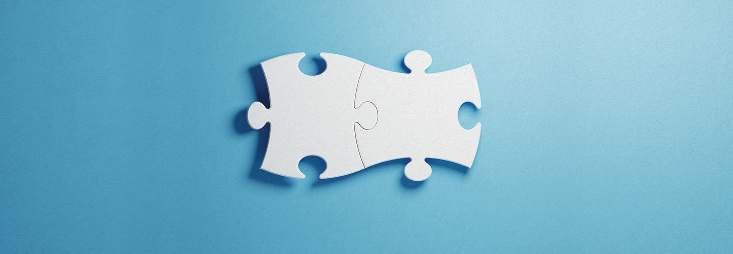 Puzzle pieces fitting together perfectly
