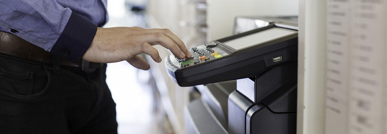 guy touching printer