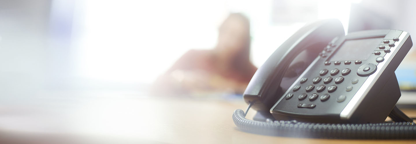 Telephone on desk in call center or office