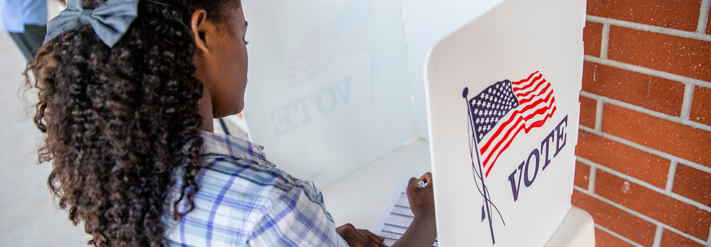Young black woman voting