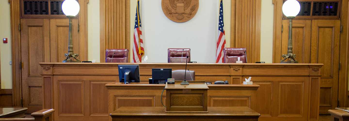 Empty courtroom with three judges' chairs