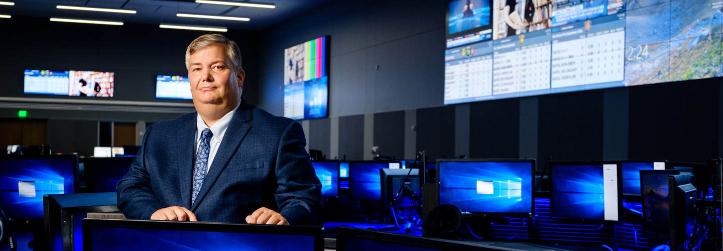 Brett Schneider, Executive Director of the Bexar Metro 911 Network, manages a state-of-the-art facility with robust audio and visual communications.