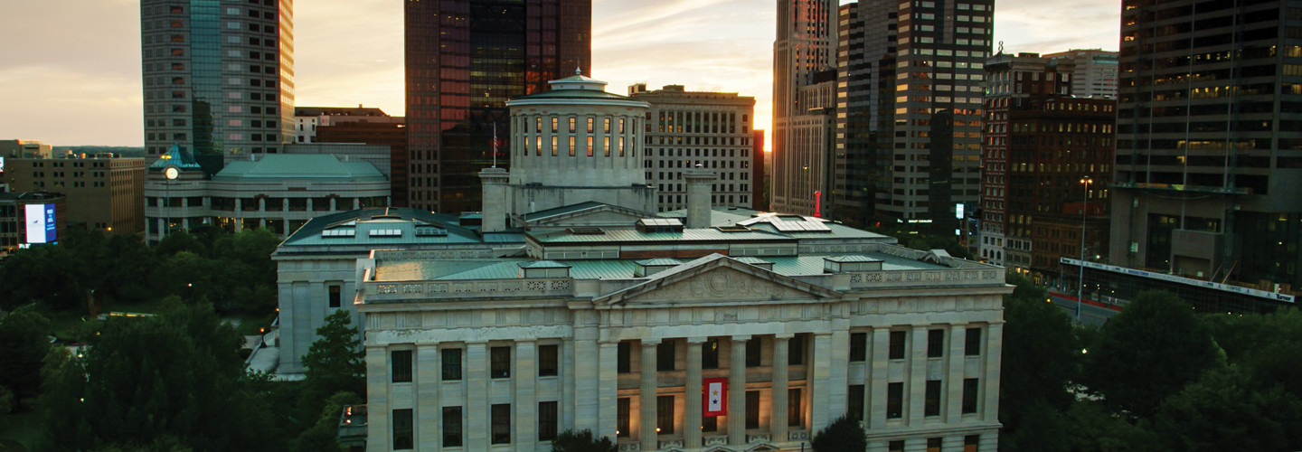 Aerial establishing shot of the Ohio Statehouse in Columbus at sunset.