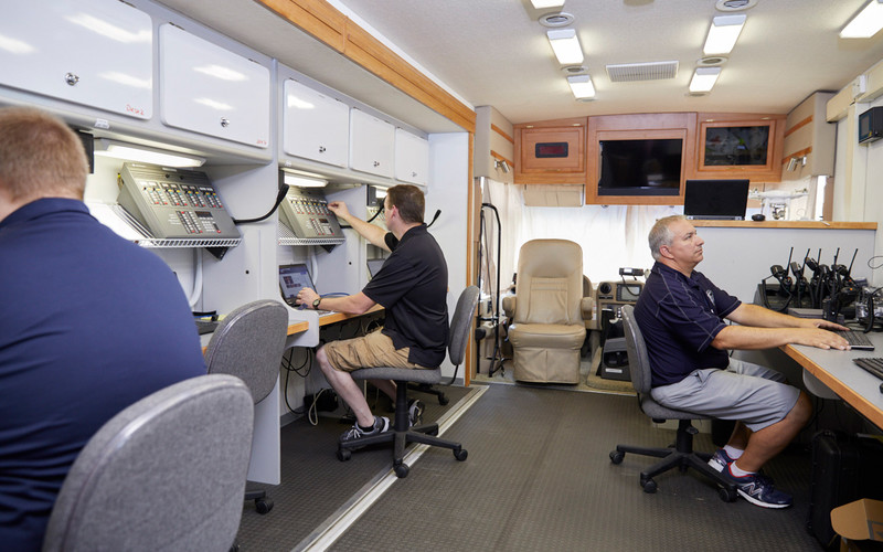 Inside the vehicle, on-scene commanders or representatives from each participating agency take a seat at a desk, where they have access to computer and radio resources.