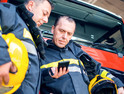 Firefighters using smartphones