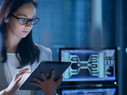 Young Female Government Employee Wearing Glasses Uses Tablet in System Control Center.