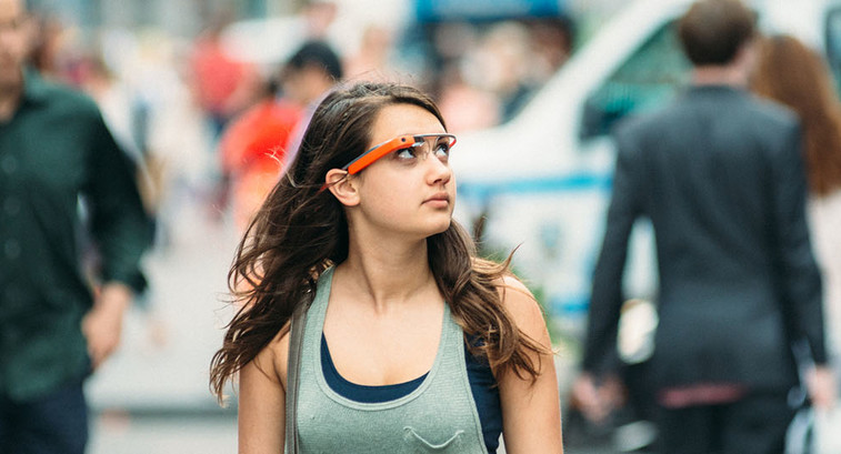 Teenage girl wearing Google Glass in Times Square