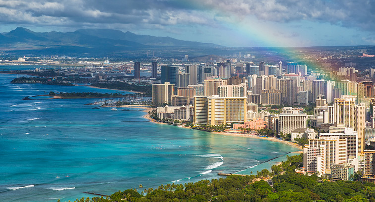 View of Honolulu harbor with a rainbow