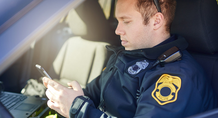 Police officer using a smartphone