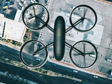 Drone hoovers over city in high angle view