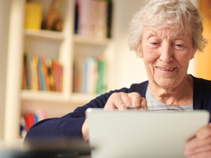 Old woman using a tablet